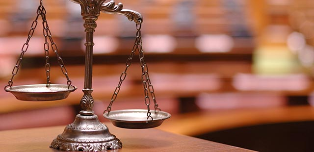 Symbol of law and justice in the empty courtroom, law and justice concept.
